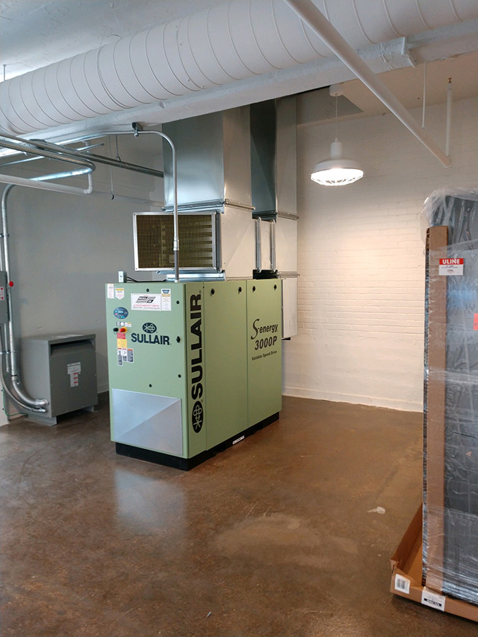 Sullair compressor installation at ISAIC